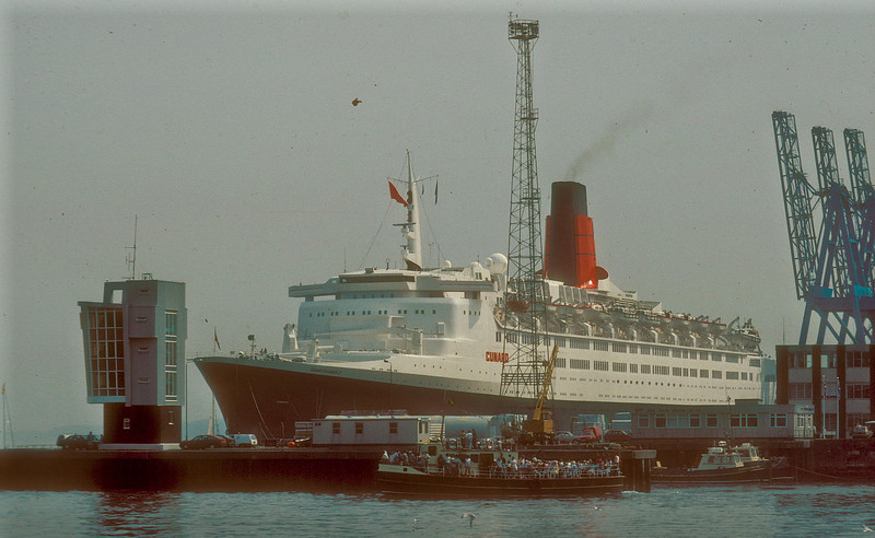 When QE2 returned to the Clyde for the first time in 1990 she was able to berth at the Greenock Ocean Terminal not far from the location of the shipyards of Greenock and Port Glasgow that had built the four original sturdy paddle steamers of the fledgling Cunard Line. After launch all four steamers were towed up the Clyde to Napier's Dock in Glasgow (now Lancefield Quay ) where their powerful steam engines were fitted. They had been built in Napier's foundry in nearby Hydepark Street, which was one of the most capable engineering workshops in Europe at that time.<br /> <br /> Picture by Stuart Cameron