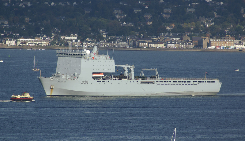 Strathclyde Passenger ferry Seabus passing RFA Mounts Bay on her way from Gourock to Helensburgh