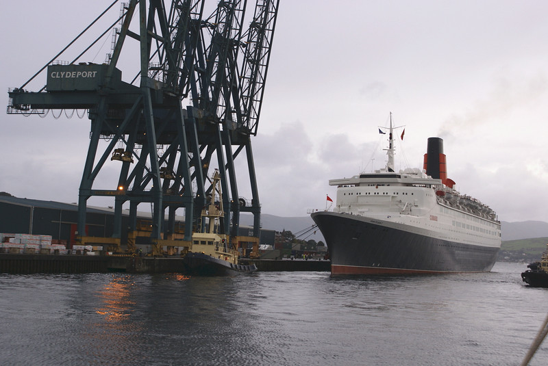 The Clyde's oldest tug, Flying Phantom, the last survivor on the river of the fleet of the world's oldest shipping company (The Clyde Shipping Company 1814-1995) was given the honour of head tug to ease QE2 off the berth.<br /> <br /> Picture by Stuart Cameron