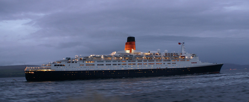 As darkness descended the huge ship was an even more impressive sight.<br /> <br /> Picture by Stuart Cameron