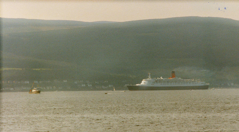 QE2 passing Wemyss Bay - the former Cunard Chairman, Lord Inverclyde, could view Cunard's new Clydebuilt liners on trials from his home nearby this spot.<br /> <br /> Picture by Tom Dunlop