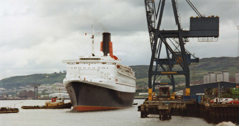 On her third visit Waverley met the liner as she arrived at the Tail of the Bank - as the tugs nudged her into the quay Capt Neill manoeuvred Waverley stern first into the end of the quay resulting in this unusual view.<br /> <br /> Picture by Stuart Cameron