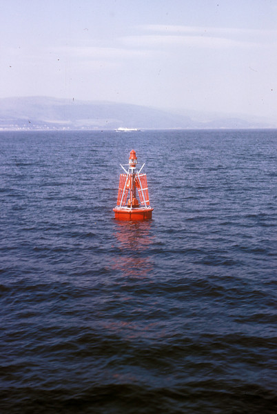 Photo by the late Mr William Davies<br /> <br /> Job done!<br /> <br /> One of the Caledonian Steam  Packet Company's (now Caledonian MacBrayne) four 'Maid' class passenger ferries can be seen in the distance, above the buoy, heading for Rothesay on the Isle of Bute.