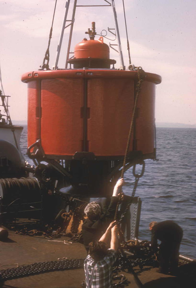 Photo by the late Mr William Davies<br /> <br /> Slewing derrick lifting the buoy