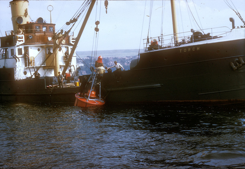 Photo by the late Mr William Davies<br /> <br /> Shipping the buoy overboard