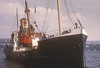 Photo by the late Mr William Davies<br /> <br /> Starting to slew the buoy overboard