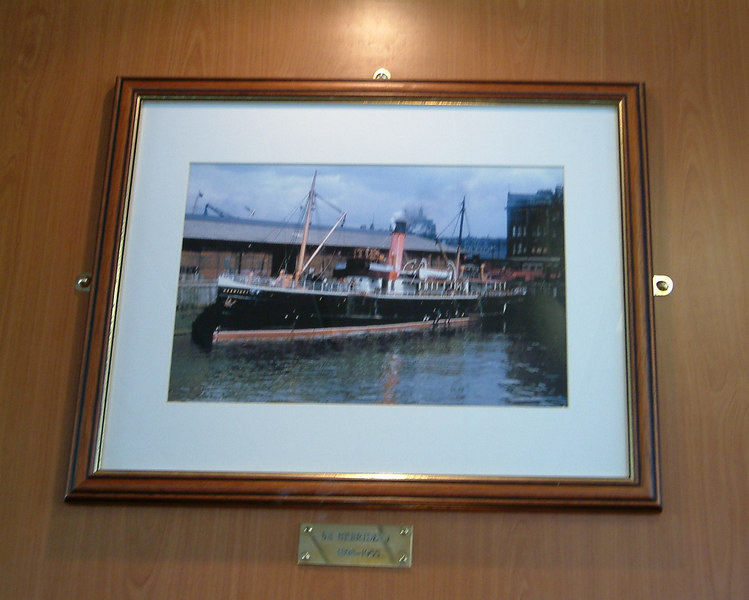 Portraits of the two previous Hebrides hang in the third vessel's upper deck lounge. This one shows the first Hebrides in the Kingston Dock in Glasgow