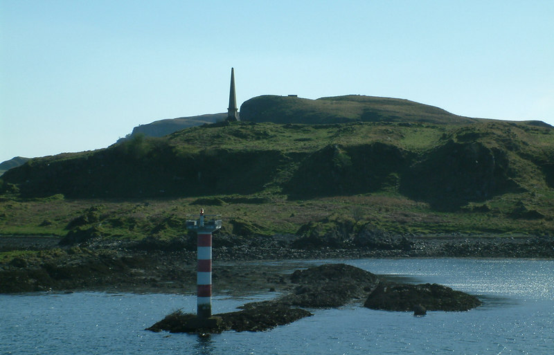 David Hutcheson's monument on Kerrera from Isle of Mull, a direct successor of Hutcheson's vessels, at the north entrance to Oban Bay.