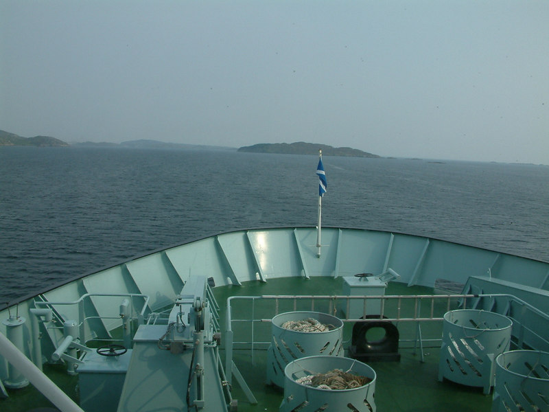 View forward from Hebrides heading east down East  Loch Tarbert with the island of Scotasay dead ahead and Scalpay in the distance