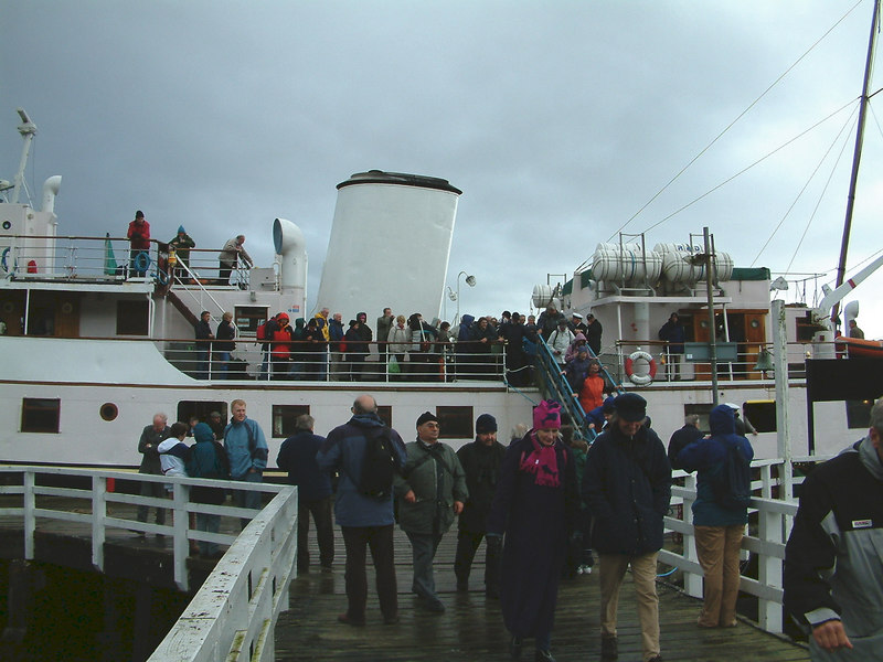 Passengers disembark from Balmoral via the promanade and main deck (later via the 'Lundy Doors') during a very high tide at Tighnabruaich