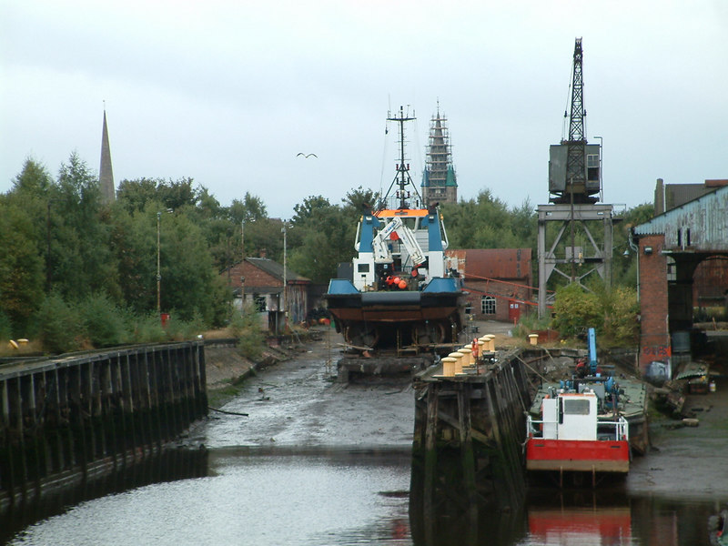 The Clyde Navigation Trust created its own ship repair yard at Renfrew following the closure of an earlier yard at Dalmuir. The Renfrew yard was provided with two slips to haul vessels out of the water for repair and a well equiped engineering workshop. For many years the yard was busy with a contrant stream of the Trust's own vessels (dredgers, hopper barges, ferries, the CNT's own tug and various harbour workboats). The conversion of the Trust into the Clyde Port Authority and its eventual privatisation meant that, for the first time in its history, the Clyde Navigation came into the ownership of a private company with very different objectives. The river fleet was confined to history and the Renfrew yard was leased to private operators. During 2003 it was announced that the yard would be closed and swept away for further high profit residential developments. This view shows the site in its final few months as a working yard. Unlie many other Clyde shipyards it was not removed because it had become redundant.