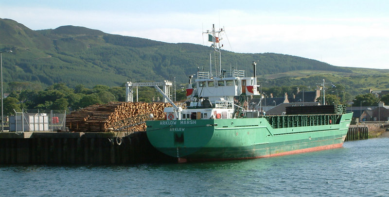 Arklow Shipping 's coastal cargo vessel Arklow Marsh loading timber at Campbeltown. Arklow Shipping are based in the town of that name on the east coast of Eire, south of Dublin.