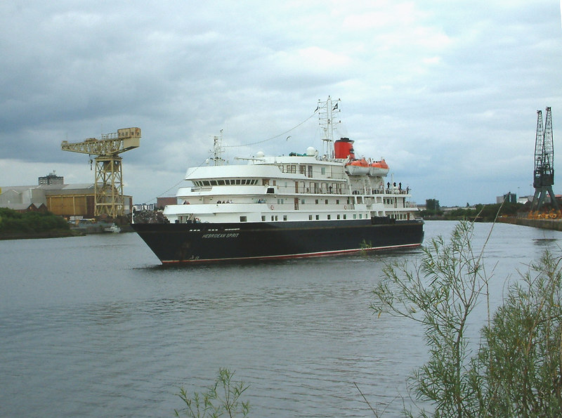 The mini cruise ship Hebridean Spirit leaving King George V dock following her first visit to the Clyde and her port of registry. In the background on the left is the Arrol giant cantilever crane of the former Barclay Curle North British Engine Works.