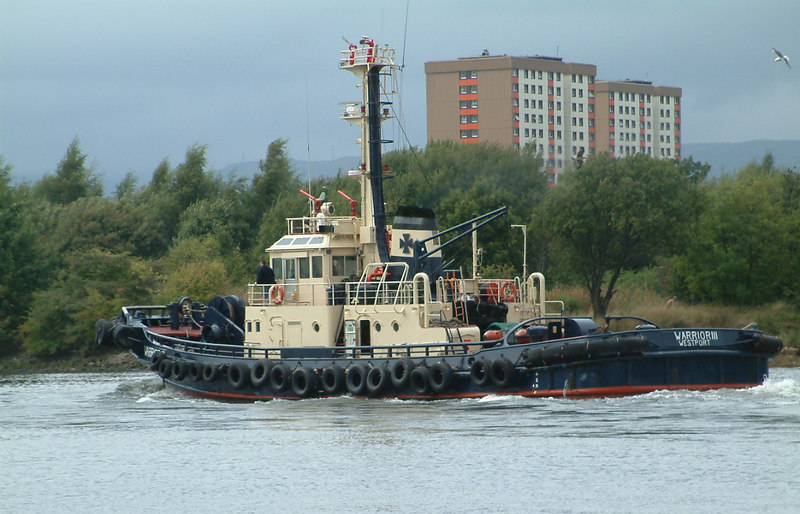 Warrior III heads downriver past Renfrew after assisting with the undocking of Orage and Rotterdam at KGV Dock