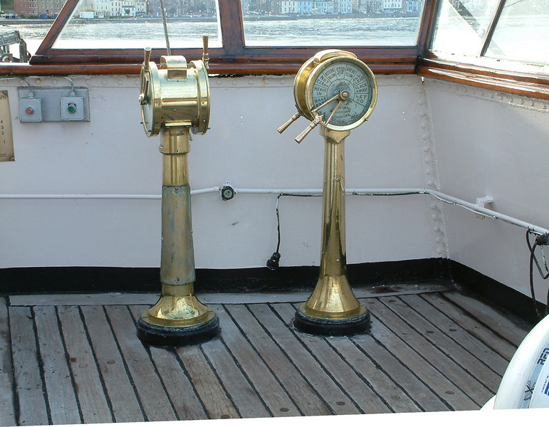 Balmoral has two  double telegraphs on each bridge wing. In this view on the starboard bridge wing, the instrument on the left is the engineroom telegraph, for sending engine movement commands to the engineers who operate the engines manually. The left lever sends the required setting for the port engine, the right lever giving the requirement for the starboard engine(Balmoral being a twin engine, twin screw vessel.) At the time that the picture was taken the port engine was running 'Slow Astern' while the starboard engine was at 'Stop'. The telegraph on the right is for sending rope handling commands to the deck crew members at the forward windlass and aft capstan during berthing and unberthing of the ship.