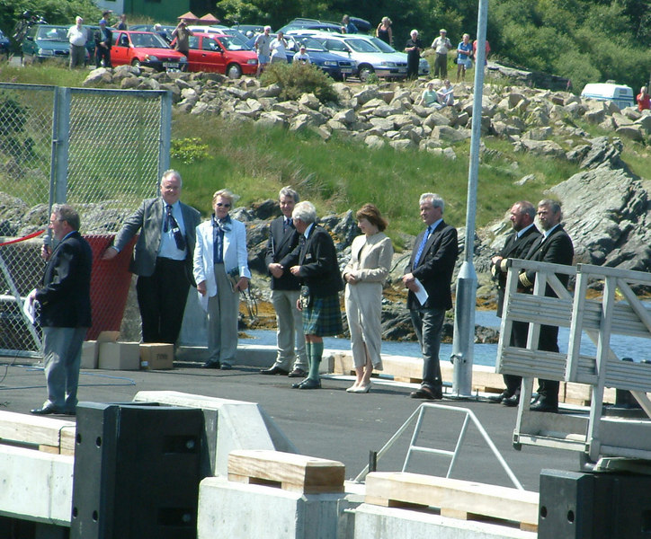 Waverley's first call at the new pier was on a fine sunny day and a special ceremony was held to mark the occasion. In this picture taken during the official opening ceremony, some of the principal participants can be seen. They are (left to right): Dr Harold Mills (Chairman, Caledonian MacBrayne), Mr Ian McCrorie (Clyde steamer historian), Mrs Olive McCrorie, Mr Lawrie Sinclair (Managing Director, Caledonian MacBrayne), two local councillors, Mr Iain MacLeod (Chairman, Waverley Steam Navigation Company), Mr Jim MacFadzean (Chief Purser, PS Waverley) and Capt Alan Jamieson (Master, PS Waverley at the time).
