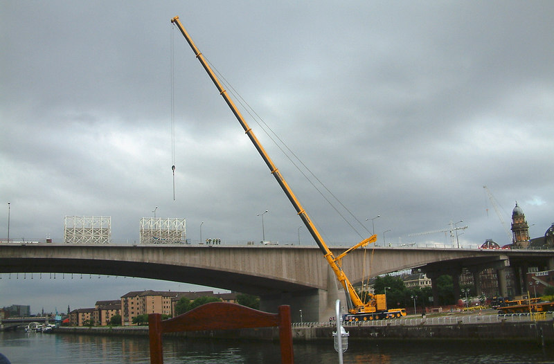 During 2003 long lasting remedial work on the Kingston Bridge just upstream of Waverley's berth at Anderston Quay came to an end. This involved lifting large structures away from the bridge using a large mobile crane on Springfield Quay. This view, which shows the crane at work, was taken from Waverley's upper deck while she was canting.