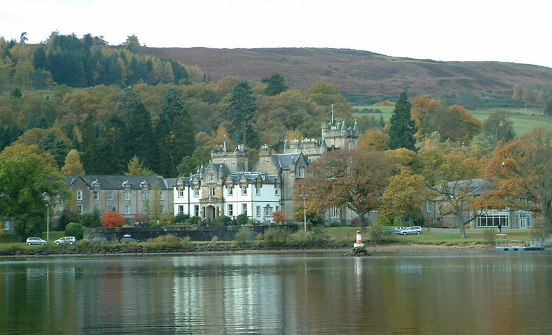 The view of Cameron House from Lomond Duchess in Drumkinnon Bay. The original building is one of several large Victorian mansions built around the southern part of Scotland's most famous loch. By this time it had been converted into a (very) upmarket hotel.