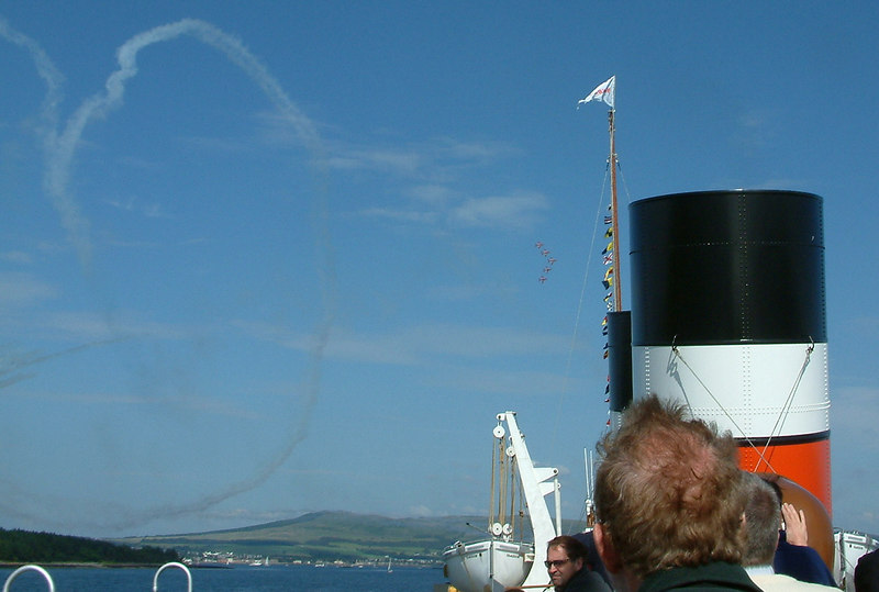 After performing a spectacular loop five aircraft pass forward of the paddler