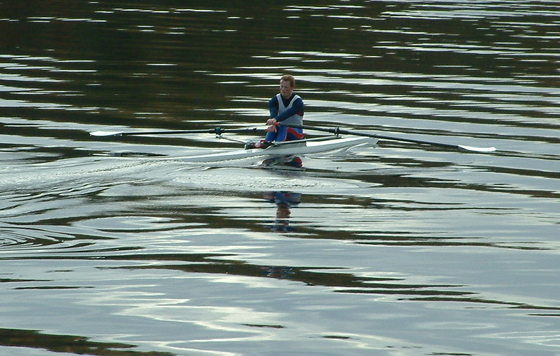 Passing a solitary rower on the Loch