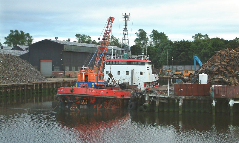 During 2003 the fitting out basin of the former Lobnitz shipyard at Renfrew, by then being used to export scrap metals by coaster, was dredged by the small grab dredger Hebble Sand. Lobnitz, together with its neighbouring yard operated by William Simons & Co and the Fleming & Ferguson yard on the River Cart,  had produced a significant proportion of the world's dredgers. Over 600 dredgers and 300 hopper barges were built in the three yards in the century between the 1860s and 1960s but it had been many since a dredger had been seen in Lobnitz Basin.