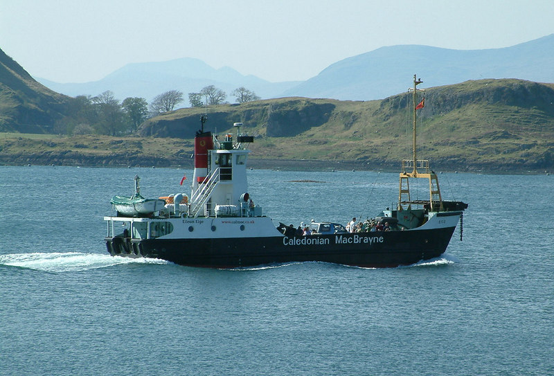 The Burness-Corlett designed island class ferry Eigg, one of eight sister ships built by Port Glasgow shipbuilders James Lamont & Co during the 1970s, departing Oban for the island of Lismore. In the near background is the island of Kerrera with the higher mountains of the isle of Mull beyond.
