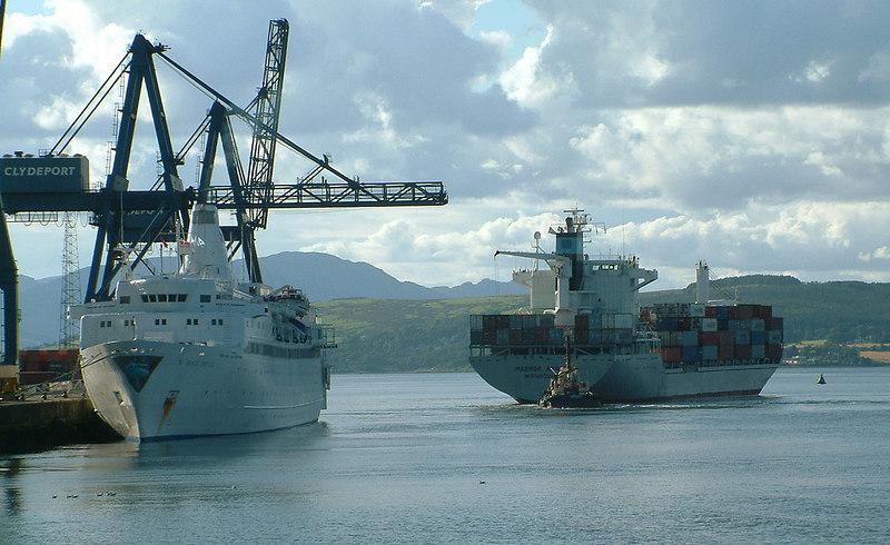 Cruise ship Black Prince at the Ocean Terminal with Maersk Apapa departing.