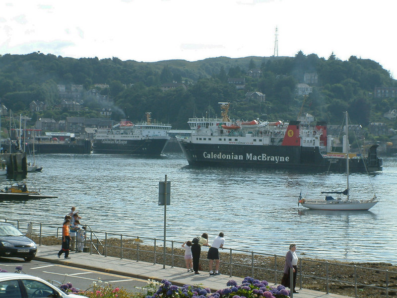 August visit to Oban with Isle of Mull and Lord of the Isles manoeuvring off the Railway  Pier