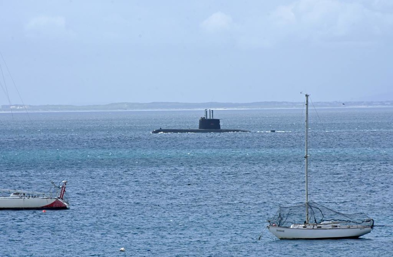 South African submarine S101 Manthatisi, Simon's Town, 13 September 2018.  Built in Kiel by Howaldtswerke, launched in 2004.  In the distance is the shore of False Bay.