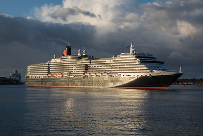 Queen Victoria glints in the early morning sunshine as she turns for the Ocean Terminal at Southampton .  10th August 2018.  Her sister ship, Queen Elizabeth is to her left, heading for 38/9 berth, returning from a Baltic cruise.