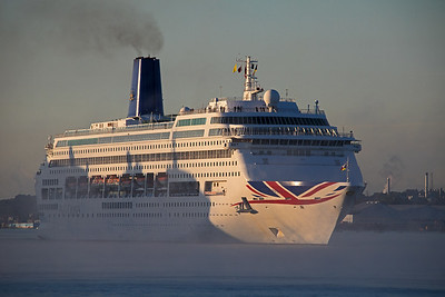 Oriana creeps through the sunshine, shadows and mist as she enters the Port of Southampton  on 11th August 2018.