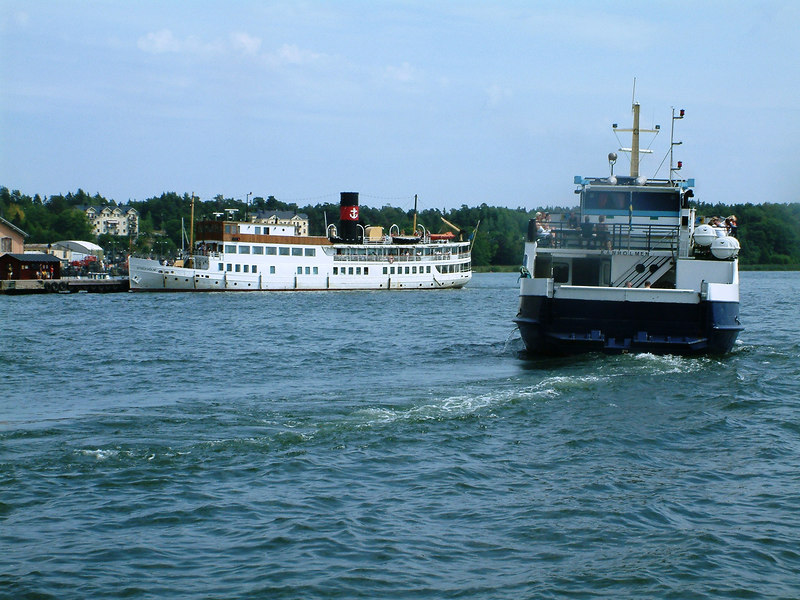 MV/SS Stockholm at Vaxholm Castle pier with the local ferry Kanholmen , 28 07 2006