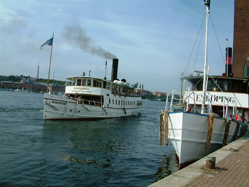 SS Mariefred leaving Klara Malarstrand, Stockholm with MV Enkoping about to leave, 28 07 2006
