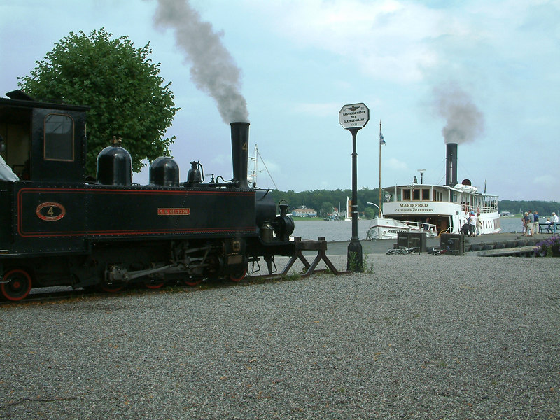 Steamship Mariefred and steam locomotive K M Nelsonn of the Östra Södermanlands Järnväg narrow guage railway at Mariefred, Sweden, 29 07 2006