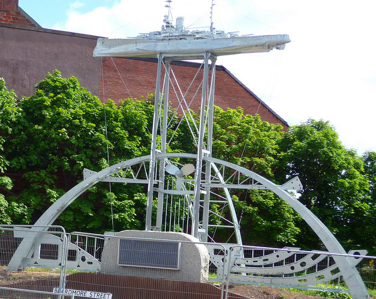 The 26-foot high 'plinth. that supports the model of Ramillies is built to a style that is reminiscent of the massive internal steel frames that had to be built into these vessels to give the hull the strength to survive the massive pounding energy of the big waves in the turbulent oceans of the world. The frames of the battleships had to be especially robust to carry the very thick, and very heavy armoured hull plates of the battleships.