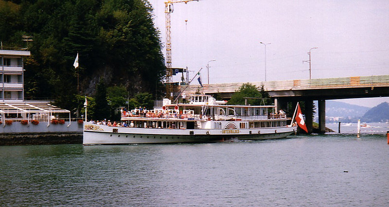 Paddle steamer Underwalden emerging from Acheregg with masts, funnel and wheelhouse retracted, heading for Alpnachsstad By this time her retracting masts had been replaced by he current folding versions