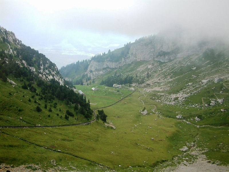 The Pilatusbahn stretching across a high meadow on Mount Pilatus