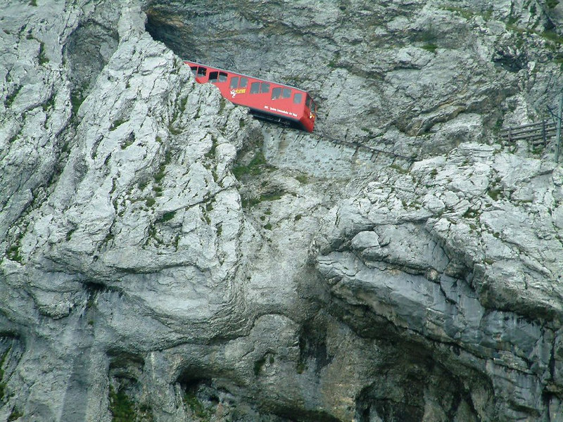 A train entering a tunnel on the spectacular Pilatusbahn