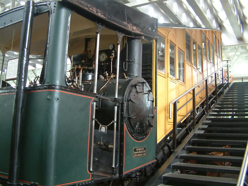 One of the original coaches and steam locomotive No 9 of the Alpnachstad - Pilatus Kulm cogwheel railway, the steepest in the world. The locomotive was built by Schweizerische Locomotiv & Maschinenfabrik (SLM) at Winterthur in 1888. Order No 504. In service from 1889 to 1937 when the Pilatus Bahn was electrified..