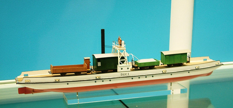 Model of the first Lake Lucerne train ferry DGV1<br /> <br /> The first train ferry in Switzerland appeared on Bodensee (Lake Constance) in 1869. Train ferries continued on this huge lake, between Romanshorn and Friedrichshafen until 1976.<br /> <br /> Between 1873 and 1893 a train ferry on Lake Thun linked an isolated railway near Interlaken with the main line to Bern at Thun <br /> <br /> DGV1 and other train ferries appeared on Lakes Lucerne and Como in 1890, lasting until the construction of the railway along the side of Lake Thun. <br /> <br /> There was a train ferry on Lake Zurich between 1885 and 1894 linking a factory to the main line.