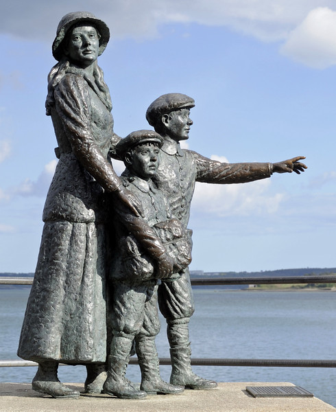 Annie Moore statue, Cobh, Fri 11 May 2012.  On 1 January 1892, Annie Moore and her brothers became the first immigrants to enter the USA through Ellis Island, New York.