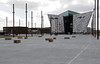 Site of the slipway where Titanic was built, Titanic Belfast, Tues 15 May 2012.  The white line marks the outline of her hull.  The Harland & Wolff drawing office where Titanic was designed is in the left distance.  The new Titanic Belfast vistor centre is at right.