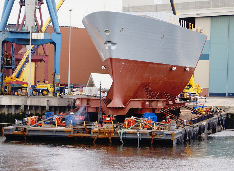 The bow section of each of the six Type 45 destroyers were built at the BVT Surface Fleet Ltd Portsmouth shipyard and delivered to Scotstoun (Daring) and Govan (Dauntless, Diamond, Dragon, Defender and Duncan) for assembly with the locally built sections. This view shows Defender's bow about to be off-loaded from the delivery barge at Govan, 5th July 2008.
