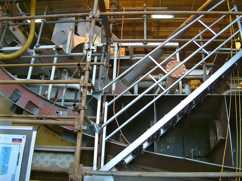 A view of the bottom hull plating, floors and bilge frames in Block D which will accommodate much of the ship's propulsion and power machinery. The pipe closed by a blank flange will mate up with its continuation in the next Block when they are brought together on the berth.