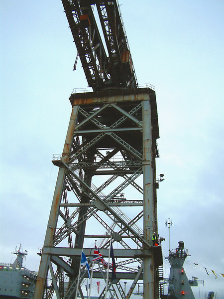 A view of the Giant Cantilever Crane built in 1911 at Sir William  Arrol & Company's Parkhead Crane Works in Nuneaton Street, Glasgow. With a maximum lift capacity of 250 tons its was recognised for many years as the largest crane in the world. However, such a capacity is now relatively small and the crane, which was employed in lifting the engines and boilers aboard the ships built at Fairfields (and the armour plating onto the hulls of the 6 battleship / battlecruisers built there) is little used nowadays.<br /> <br /> This crane was demolished later in 2007 to provide space for the anticipated future RN aircraft carrier sections.