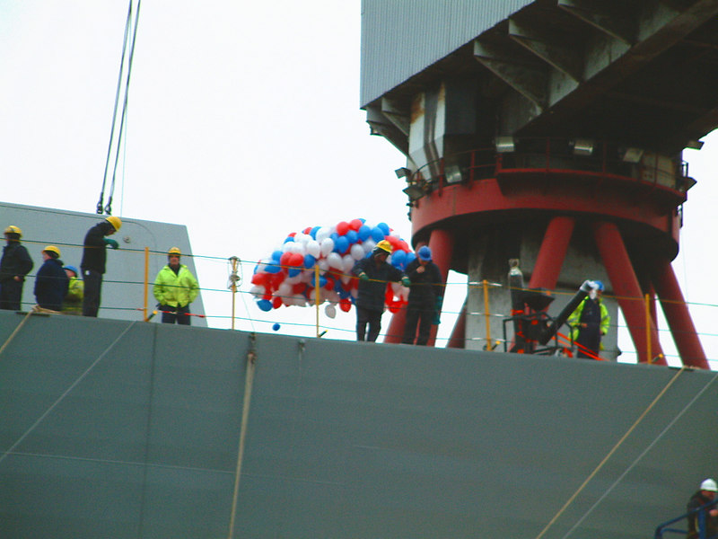 The shipyard workers on board await the launch - they would have lots to do when she was afloat.