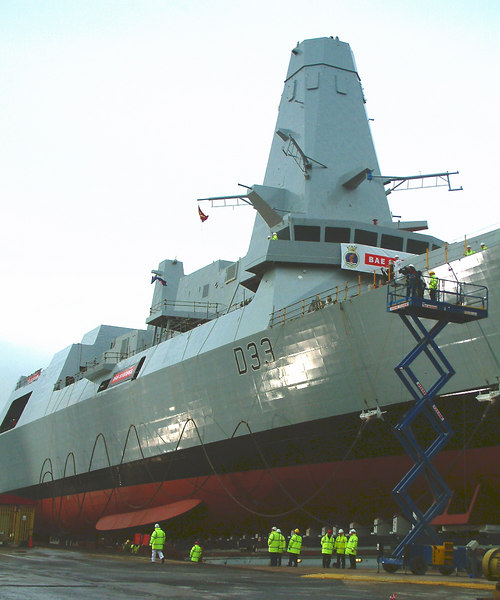 A view of Dauntless amidships. Her 'stealth' profile, with minimised right angles in her structural design, gives her a low 'radar signature' and the flue gases from her Roll Royce gas turbine prime movers will be cooled to minimise her 'thermal signature' making her hard to detect. The massive mast above the wheelhouse will house the sophisticated tracking systems that allow all ships in her class to monitor as much airborne activity as all simultaneous flights in and out of London Heathrow, Paris Charles de Gaulle and Amsterdam Schiphol airports