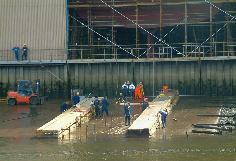 Here we see the staff at Scotstoun preparing the ways on one such low tide on the morning of 24th July 2005 - fully six months before the launch