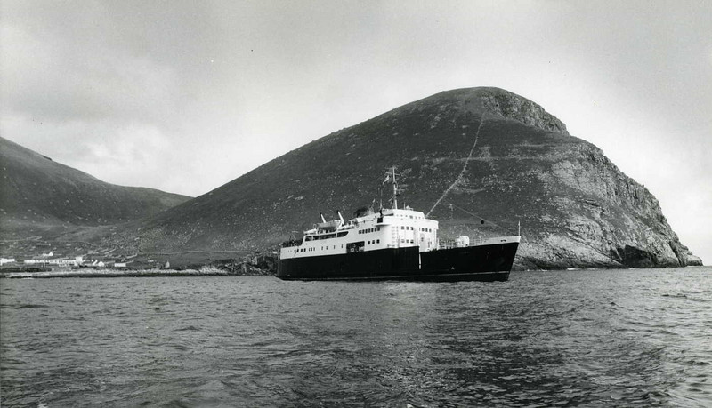 Motor Vessel Columba in Village Bay, St Kilda with the village and Oeseval behind