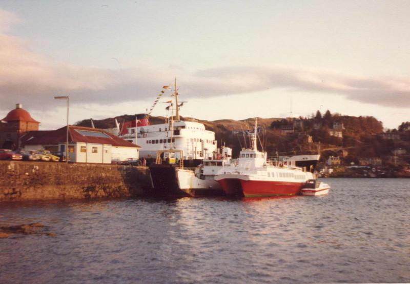 On 5th May 1979 the 15 year old passenger and car ferry Columba left the Caledonian MacBrayne shipping company's headquarters at Gourock in Renfrewshire at 0915 and sailed out to the mouth of the Firth of Clyde passing the islands of Great and Lesser Cumbrae, Bute and Arran The vessel rounded the world famous Mull of Kintyre and entered the waters of the southern Hebrides. <br /> <br /> Columba arrived at Oban North Pier at 2020 that evening and approximately one hour was spent unloading the complement of cars that she had carried round from Gourock <br /> <br /> In this view she is seen berthed at the North Pier, Oban with a bow loading Caledonian MacBrayne 'Island'class' ferry and the Western Ferries' passenger catamaran Highland Seabird also alongside. <br /> <br /> At 2200 Columba left the North Pier with approximately 280 passengers aboard for the most unusual sailing of her entire MacBrayne career. She headed up the Sound of Mull and, not long after midnight, she was passing the famous lighthouse at  Ardnamurchan Point, the most westerly headland of the British mainland. Her course was set towards Lochboisdale on the island of South Uist in the Outer Hebrides.